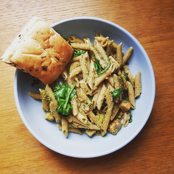 vegan pasta and bread roll in a bowl