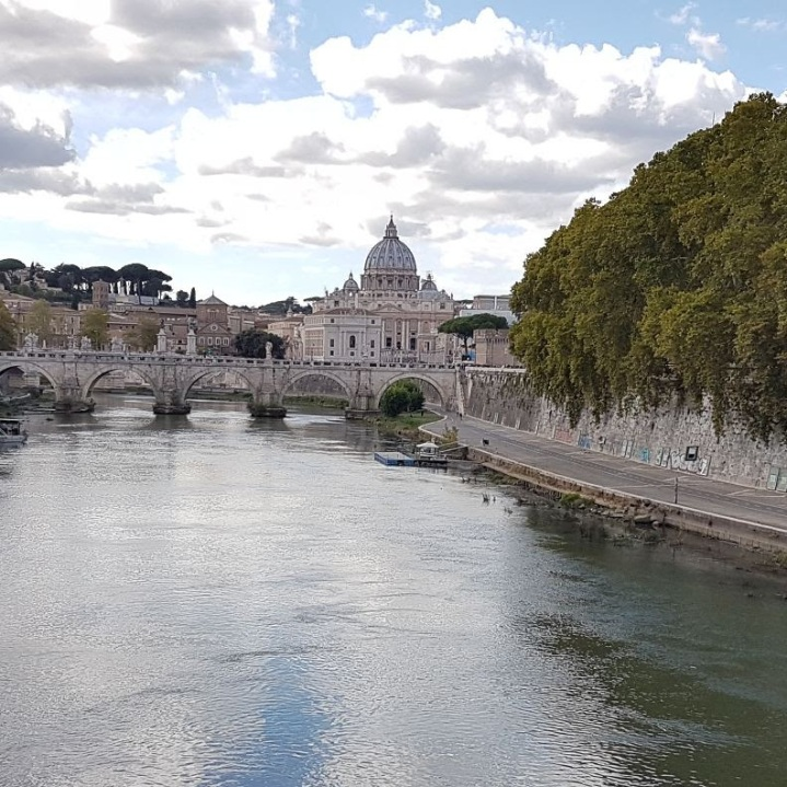 castle behind river in rome