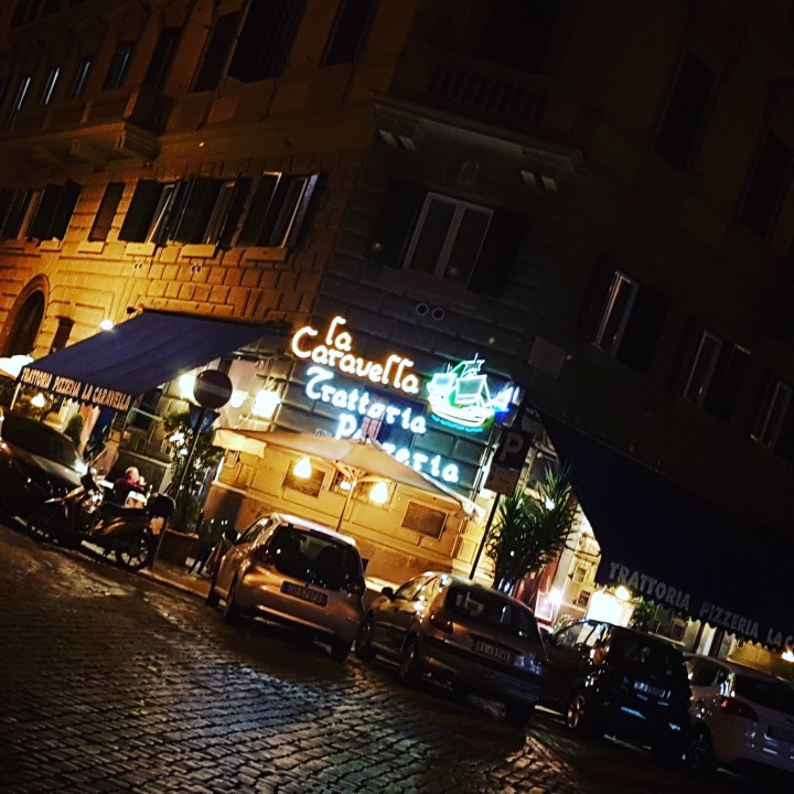 restaurant and illuminated sign in Rome