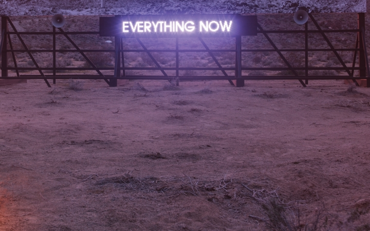 illuminated sign saying 'everything now' in the desert