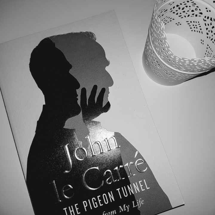 john le carre book in black and white on desk